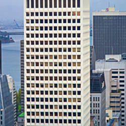 Skyscrapers in the financial district with the bay bridge in the background, San Francisco, California, USA