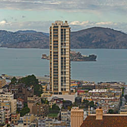 Buildings in a city with Alcatraz Island in San Francisco Bay, San Francisco, California, USA
