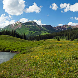 Man camping along Slate River, Crested Butte, Gunnison County, Colorado, USA