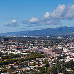 Buildings in a city with mountain range in the background, Santa Monica Mountains, Los Angeles, California, USA