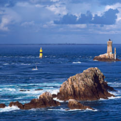 Lighthouse in the sea, Pointe Du Raz, La Vieille Lighthouse, Finistere, Brittany, France