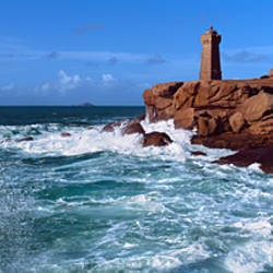 Lighthouse at a coast, Ploumanach Lighthouse, Cote De Granit Rose, Cotes-d'Armor, Brittany, France