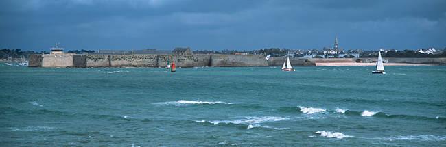 Sailboats in front of citadel, Vauban Citadel, Port-Louis, Morbihan, Brittany, France