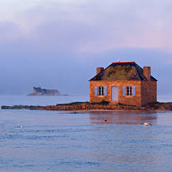 Fisherman house in a river at sunrise, Etel River, Morbihan, Brittany, France