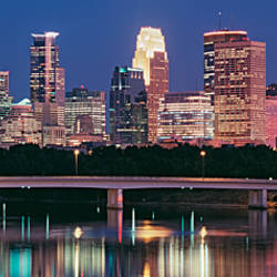 Buildings lit up at night in a city, Minneapolis, Mississippi River, Hennepin County, Minnesota, USA