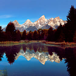Reflection of mountains with trees in the river, Teton Range, Snake River, Grand Teton National Park, Wyoming, USA