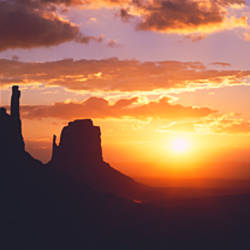 Silhouette of buttes at sunset, The Mittens, Monument Valley Tribal Park, Monument Valley, Utah, USA