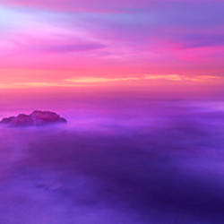 Fog reflected in the sea at sunset