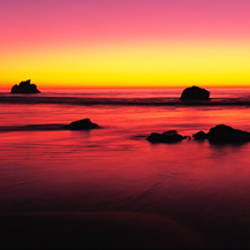 Sunset over rocks in the ocean, Big Sur, California, USA