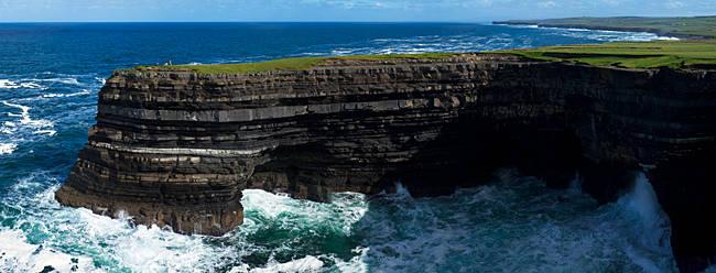 Distant Sea anglers on Downpatrick Head, County Mayo. Ireland