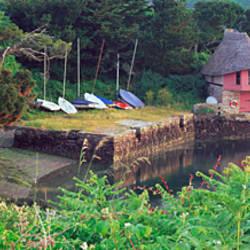 Thatched roofed boathouse on the coast, Bantham, South Hams, Devon, England