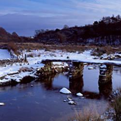 Bridge over a river, Granite Clapper Bridge, Postbridge, River Dart, Dartmoor, Devon, England