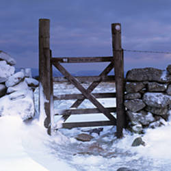 Snow covered gate in dry-stone wall, Dartmoor, Devon, England