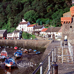 Buildings in a village with boats in the river, Lynmouth, North Devon Coast, Devon, England