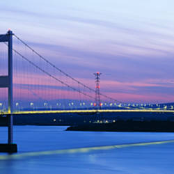 Bridge across a river at dusk, Severn Bridge, Aust, Gloucestershire, England