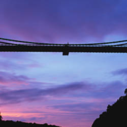 Low angle view of suspension bridge at sunset, Clifton Suspension Bridge, Bristol, England