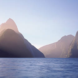 Mountain range at water's edge, Milford Sound, Fiordland National Park, South Island, New Zealand