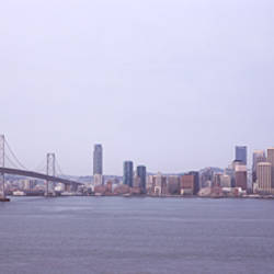 Bridge with city skyline in the background, Bay Bridge, San Francisco Bay, San Francisco, California, USA 2010