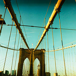 Suspension bridge with a city in the background, Brooklyn Bridge, Manhattan, New York City, New York State, USA