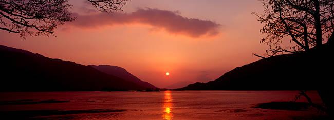Sunset over a lake, Loch Leven, Ballachulish, Lochaber, Highlands Region, Scotland