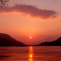 Sunset over a lake, Loch Leven, Ballachulish, Lochaber, Highlands Region, Scotland