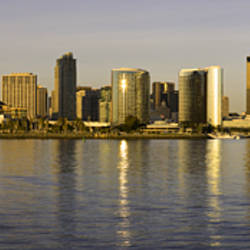 Reflection of skyscrapers in water at sunset, San Diego, California, USA