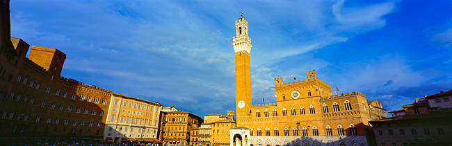 Sunlight falling on buildings, Torre Del Mangia, Palazzo Pubblico, Piazza Del Campo, Siena, Tuscany, Italy