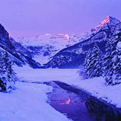 Lake in winter with mountains in the background, Lake Louise, Banff National Park, Alberta, Canada