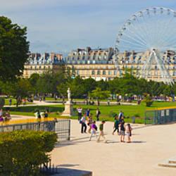 Tourists in a garden, Jardin de Tuileries, Paris, Ile-de-France, France