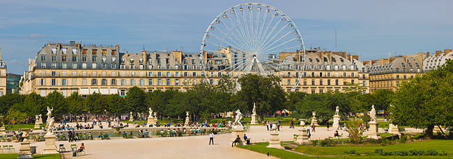 Tourists in a garden, Jardin de Tuileries, Paris, Ile-de-France, France