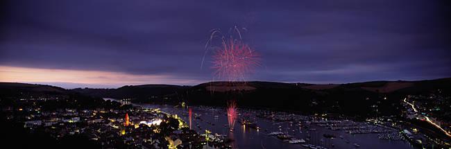 Fireworks display at night over a town during regatta, Dartmouth, Devon, England