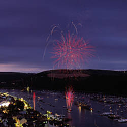 Fireworks display at night over a town during regatta, Dartmouth, Devon, England