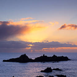Island in the ocean during sunset, Renney Rocks, Heybrook Bay, South Hams, Devon, England