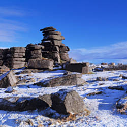 Rock formations on a snow covered landscape, Staple Tor, Dartmoor, Devon, England