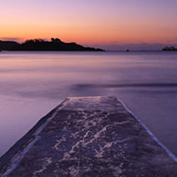 Pier over the ocean at sunrise, Plymouth, Devon, England