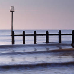 Wooden posts in an ocean, Dawlish Warren, Dawlish, Teignbridge, Devon, England