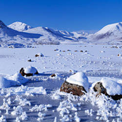 Frozen lake in front of a mountain range, Black Mount, Highlands Region, Scotland