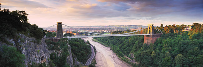 Bridge across a river at sunset, Clifton Suspension Bridge, Avon Gorge, Avon River, Bristol, England