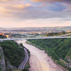 Bridge across a river at sunset, Clifton Suspension Bridge, Avon Gorge, Avon River, Bristol, England