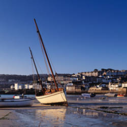 Boats in low tide at a harbor, St. Ives, Cornwall, England