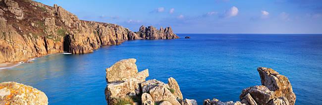 Rock formations at seaside, Logan rock, Porthcurno Bay, Cornwall, England