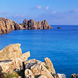 Rock formations at seaside, Logan rock, Porthcurno Bay, Cornwall, England