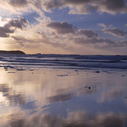 Reflection of clouds on the beach, Fistral Beach, Cornwall, England
