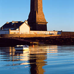 Reflection of lighthouse in water, Phare d'Eckmuhl, Penmarch, Finistere, Brittany, France