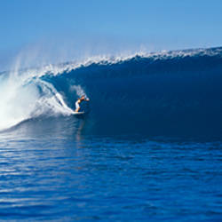 Surfer in the sea, Tahiti, French Polynesia
