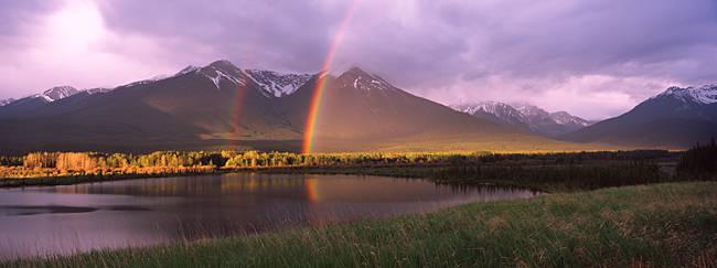 Double rainbow over mountain range, Alberta, Canada