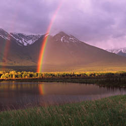 Double rainbow over mountain range, Alberta, Canada