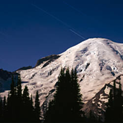 Star trails over mountains, Mt Rainier, Washington State, USA