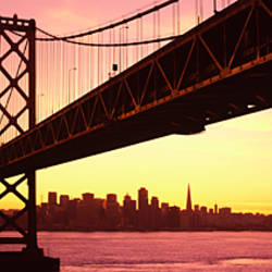 Bridge across a bay with city skyline in the background, Bay Bridge, San Francisco Bay, San Francisco, California, USA