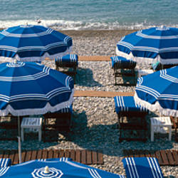 Beach umbrellas on the beach, Nice, Alpes-Maritimes, Provence-Alpes-Cote d'Azur, France